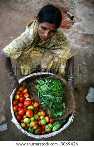 Indian woman selling vegetables - stock photo