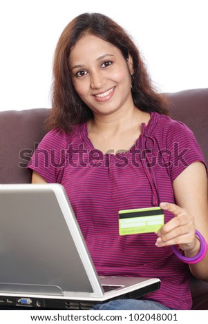Indian woman shopping online from home