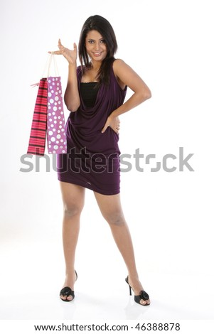 Indian woman standing with shopping bags