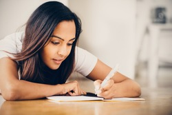 Indian woman student education writing studying