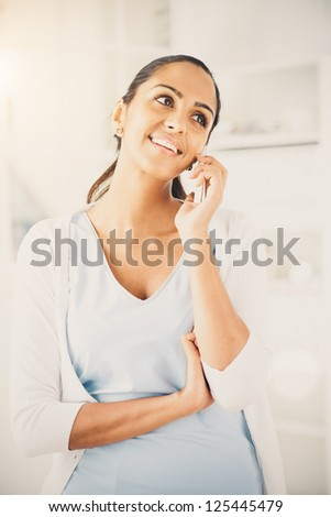 Indian woman using mobile phone happy beautiful