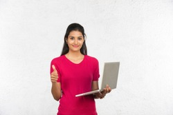 indian working woman using laptop, white background