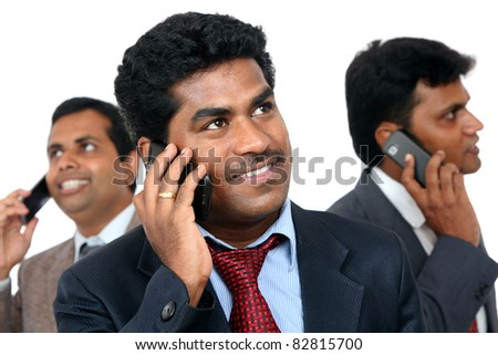 Indian young business peoples talking in mobile phone.