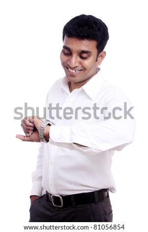 Indian young businessman looking at the watch/ Indian young businessman / Indian young businessman