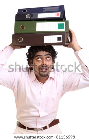 Indian young businessman lot of files on his head