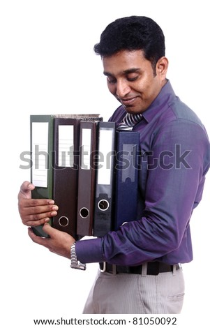 Indian young businessman posing with documents / Indian young businessman / Indian young businessman