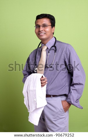 Indian young doctor posing to the camera.