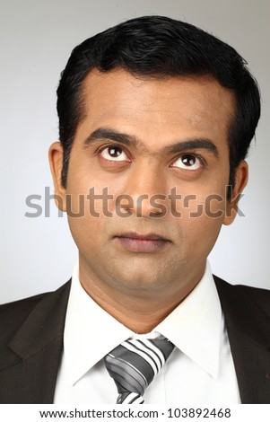 indian young man looking up