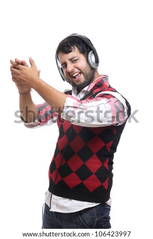 Indian young man with headphone on white background. - stock photo