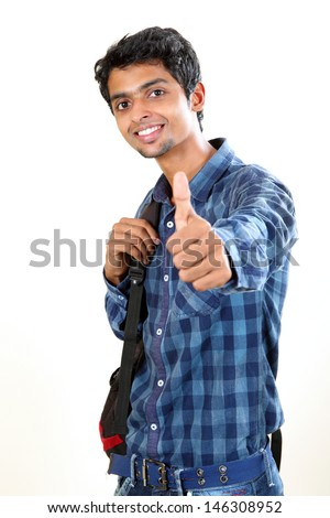 Indian Young Student Carrying Bag On White And Showing ...