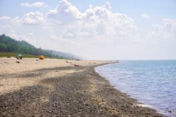 Indiana Dunes National Park Kemil Beach and Dunbar Beach area. Sunbathers on a rocky beach of Lake Michigan.