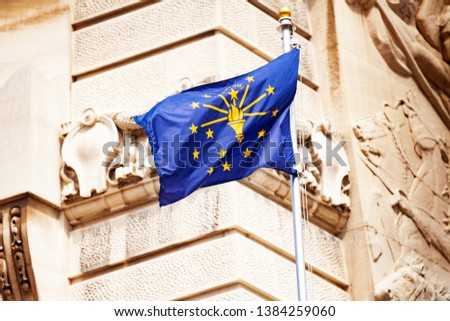 Indiana flag against Soldiers and Sailors monument #1384259060