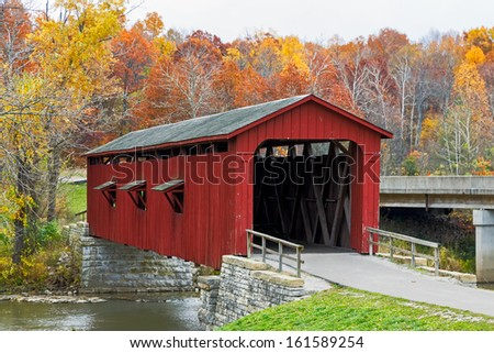 Indiana's Cataract Covered Bridge is photographed with brilliant fall foliage.