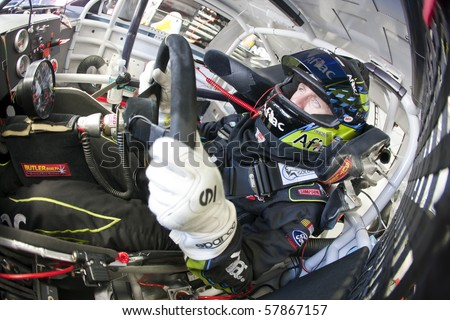INDIANAPOLIS, IN - JULY 24:  Carl Edwards straps into his Aflac Ford before a practice session for the Brickyard 400 race at the Indianapolis Motor Speedway on July 24, 2010 in Indianapolis, IN.