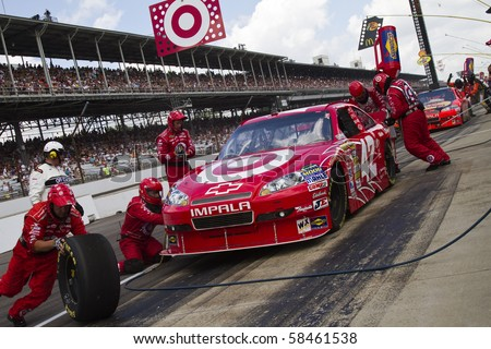 INDIANAPOLIS, IN - JULY 25:  Juan Pablo Montoya makes a pit stop for the Brickyard 400 race at the Indianapolis Motor Speedwayon July 25, 2010 in Indianapolis, IN.