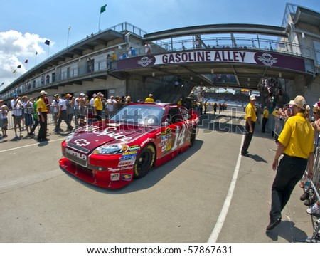 INDIANAPOLIS, IN - JULY 24:  Tony Stewart brings his Old Spice Chev back into the garage area for the Brickyard 400 race at the Indianapolis Motor Speedway on July 24, 2010 in Indianapolis, IN.