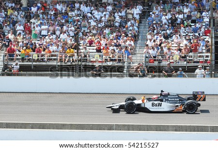 INDIANAPOLIS, IN - MAY 30: Indy car driver alex tagliani is running in the Indy 500 race May 30, 2010 in Indianapolis, IN - stock photo