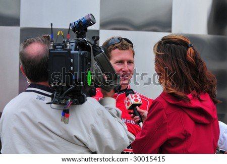INDIANAPOLIS, IN - MAY 9: Indy car driver Ryan Briscoe gives interview to media after his qualify run of Indy 500 May 9, 2009 in Indianapolis, IN