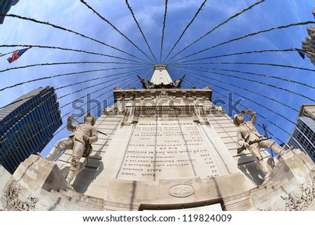 INDIANAPOLIS, IN - NOVEMBER 23: Monument Circle, pictured on November 23, 2012, is home to the Indiana Soldiers' and Sailors' Monument, honoring veteran Hoosiers of the American Revolution. - stock photo
