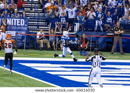 INDIANAPOLIS, IN - SEPT 2: Colts running back Brandon James scores a touchdown in football game between Indianapolis Colts and Cincinnati Bengals on September 2, 2010 in Indianapolis, IN