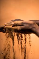 Indigenous Australian hands touching earth