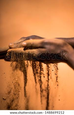 Indigenous Australian hands touching earth  #1488699212