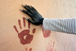 Indigenous Australian woman hand print on a wall. Copy space