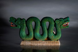 Indigenous cultures and native american tribe heritage concept with an Aztec double headed serpent or snake that is believed to represent the Quetzalcoatl god known as the feathered serpent
