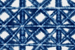 Indigo Blue Shibori Tie dye fabric texture pattern. White and Blue colors