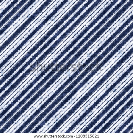Indigo-Dyed Effect Grain Stroke Textured Diagonal Striped Background. Seamless Pattern. #1208315821