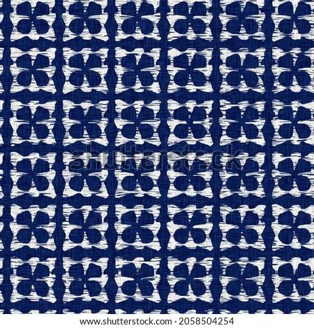 Indigo dyed fabric geo shape pattern texture. Seamless textile fashion cloth dye resist all over print. Japanese kimono block print. High resolution batik effect