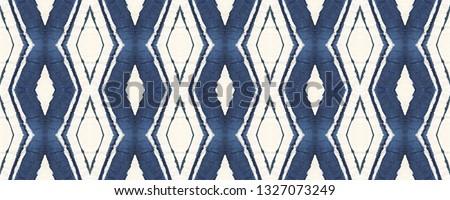Indigo Ethnic decorative geo tile. Tie dye Seamless Pattern. Watercolor chevron striped tile. Trendy Rhombuses. Ornate ikat print. Boho shibori batik repeat. Abstract indigo blue tie dye pattern
