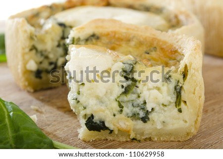 Individual goat's cheese and spinach quiches.