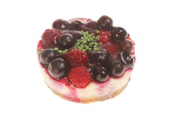 Individual mixed berry mini cheesecake isolated against white