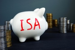 Individual savings account ISA written on a side of piggy bank.