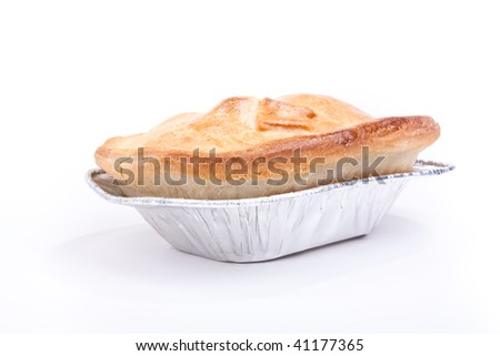Individual short crust pastry steak pie in silver foil tray isolated against white background - stock photo