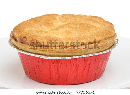 Individual steak pie in foil tray. - stock photo