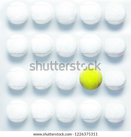Individuality concept with tennis balls top view All white and one different
