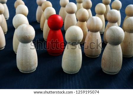 Individuality, personality and originality concept. Red wooden figure in crowd. #1259195074
