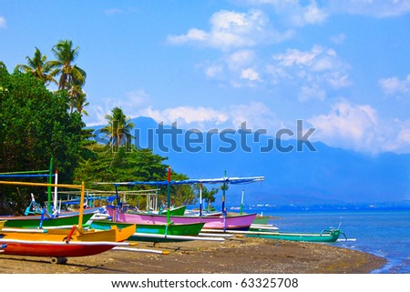 Indonesia. Bali. Traditional national boats on an ocean coast