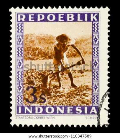 "INDONESIA-CIRCA 1947: A stamp printed in Indonesia shows Peasant with spelling ""Repoeblik"", without inscription, from series ""Indonesian Vienna Issues"", circa 194"