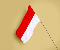 Indonesia flag fluttering on a subtle yellow background