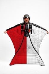 Indonesia flag travel. Bird Men in wing suit flag. Sky diving men in parashute. Patriotism, men and flag.