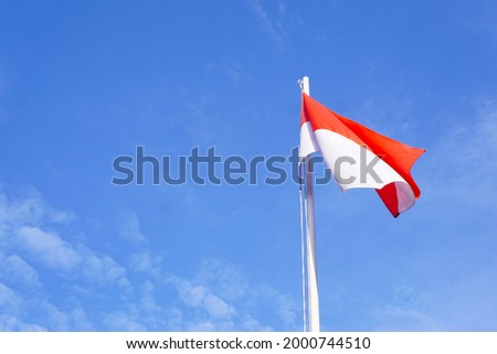 indonesia's national flag flutters against the backdrop of the blue sky Stock fotó ©