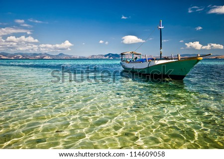 Indonesia, traditional boat in cristal water