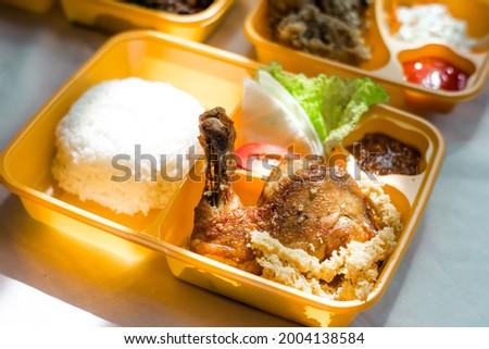 Indonesian Ayam kremes on bento box. indonesian traditional food. fried chicken. take away food. bento food Stock fotó ©