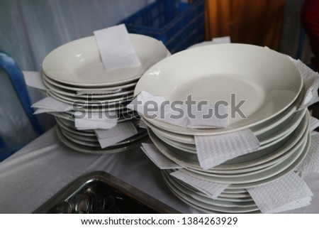 Indonesian ceremony's food and drink, food plates with cleaner papers. #1384263929