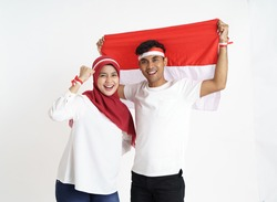 indonesian couple celebrating indonesia independence day together over white background
