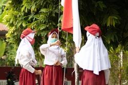 Indonesian elementary student do flag raising preparation in school