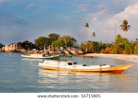 Indonesian fishing boats in small harbor